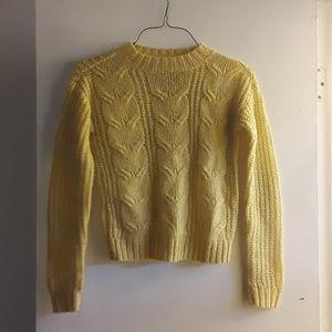 Yellow knit sweater.